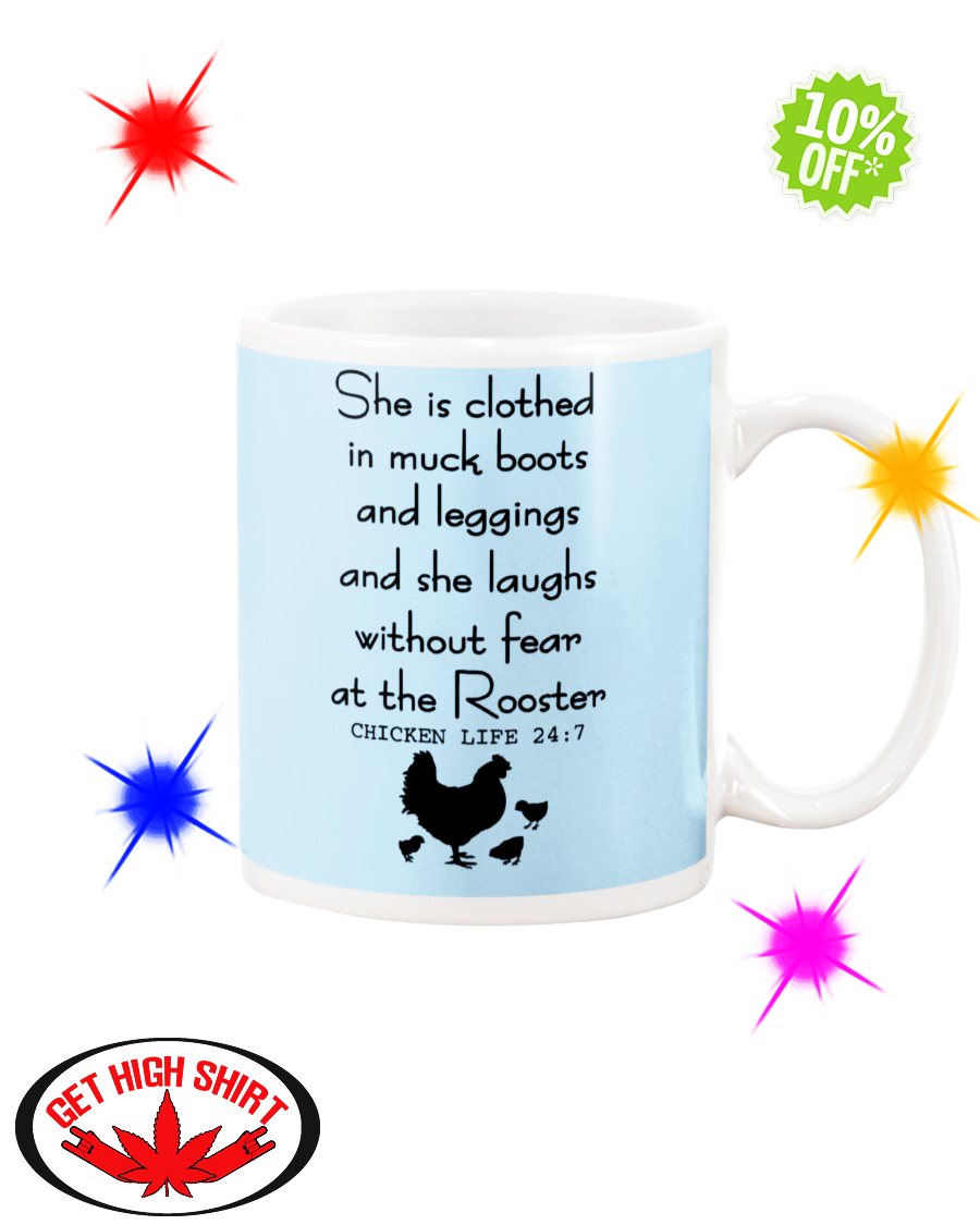 She is clothed in muck boots and leggings and she laughs without fear at the Rooster Chicken Life 24 7 Light Blue mug